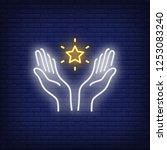 open hands and star neon sign.... | Shutterstock .eps vector #1253083240