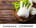 raw fresh fennel on the rustic... | Shutterstock . vector #1253090089