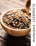 mix of raw legumes on the... | Shutterstock . vector #1253090176