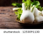 raw fresh fennel on the rustic... | Shutterstock . vector #1253091130