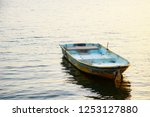 Old rowboat floating on the...