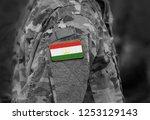 flag of tajikistan on soldiers... | Shutterstock . vector #1253129143