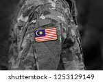 flag of malaysia on soldiers... | Shutterstock . vector #1253129149