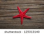 Close Up Of Red Starfish On Old ...