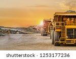 Large Yellow Dump Trucks...