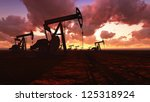 Oil Field Pump Jacks At  Sunset