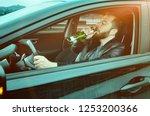 a drunken man driving a car... | Shutterstock . vector #1253200366