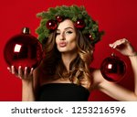 beautiful woman with christmas... | Shutterstock . vector #1253216596