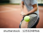 moving tennis ball being hit by ... | Shutterstock . vector #1253248966