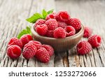 raspberry on wooden board | Shutterstock . vector #1253272066