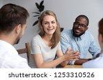 cheerful diverse millennial... | Shutterstock . vector #1253310526