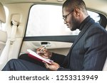 a young business man in a suit... | Shutterstock . vector #1253313949