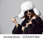 young fashion girl in fur coat... | Shutterstock . vector #1253347366