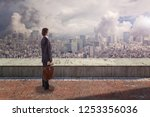 side back view of a businessman ... | Shutterstock . vector #1253356036