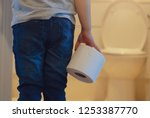 rare view of kid holding toilet ... | Shutterstock . vector #1253387770