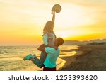 a couple have fun on the beach | Shutterstock . vector #1253393620