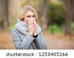 girl sneezing in tissue. young... | Shutterstock . vector #1253405266