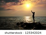 silhouette of woman on the sea | Shutterstock . vector #125342024