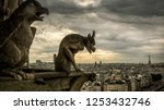 Gargoyles or chimeras on old...