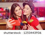 two young girls at a party in... | Shutterstock . vector #1253443936