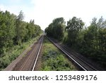 railway in the forest | Shutterstock . vector #1253489176