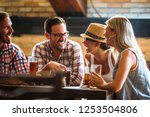 young cheerful people in the... | Shutterstock . vector #1253504806