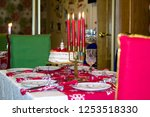 laying new year's table for a... | Shutterstock . vector #1253518330