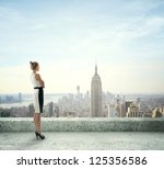 woman on roof looking at city | Shutterstock . vector #125356586