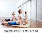 young girls do yoga indoors | Shutterstock . vector #125357543