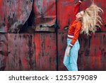 lifestyle fashion portrait of... | Shutterstock . vector #1253579089