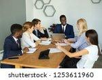 team of young businessmen men... | Shutterstock . vector #1253611960