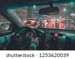 driving a car at night | Shutterstock . vector #1253620039