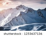 Grand view over steep slopes on a sunny winter day. Location place famous ski resort Silvretta Arena Ischgl/Samnaun on the Swiss Austrian border. State Tyrol, Europe. Discover the beauty of earth. - stock photo