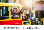 a couple of blogger tourists... | Shutterstock . vector #1253692213