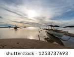 boat on the beach in coron ... | Shutterstock . vector #1253737693