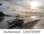 boat on the beach in coron ... | Shutterstock . vector #1253737699