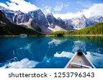 lake canoe reflection | Shutterstock . vector #1253796343