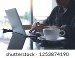freelance man working on laptop ... | Shutterstock . vector #1253874190