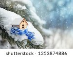 christmas toy house is wrapped... | Shutterstock . vector #1253874886