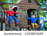 two little boys playing... | Shutterstock . vector #1253892049