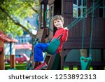 smiling little boy and his... | Shutterstock . vector #1253892313