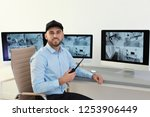 male security guard with... | Shutterstock . vector #1253906449