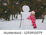 pretty little girl in winter... | Shutterstock . vector #1253910379