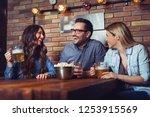 happy friends group drinking... | Shutterstock . vector #1253915569