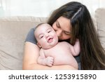 mother is kissing her cute... | Shutterstock . vector #1253915890