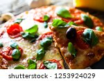 pizza on wood with ingredients. ... | Shutterstock . vector #1253924029