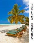 sunbed on maldives beach  ...   Shutterstock . vector #1253946013