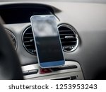 modern smartphone mockup in car ... | Shutterstock . vector #1253953243