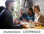 happy young friends hangout in... | Shutterstock . vector #1253984623