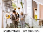 group of businessmen and... | Shutterstock . vector #1254000223